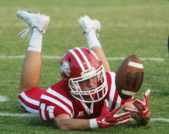 Globe/Roger Nomer<br /> Baxter Springs' Jacob Burks unsuccessfully tries to pull in a pass during Friday's game against Galena at Baxter Springs.