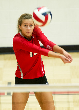 Carl Junction's Olivia Lewis handles a Grainville spike during a semifinal match of the Dr. Jeffrey Knutzen CJ Classic Volleyball Tournament on Saturday at CJHS.<br /> Globe | Laurie Sisk