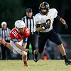 Globe|Israel Perez<br /> Cassville's DJ White (3) runs the ball as he gets past the tackle of Seneca's Alex Cook (25) during their homecoming game on Friday night at Seneca High School.