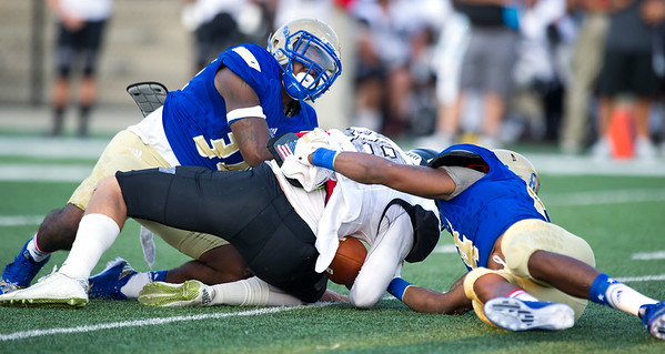 Northeastern Oklahoma A&M linebackers Joe Williams, left and Chris Bishop, right, sack New Mexico Military Institute quarterback Jaime Rouse during their game on Saturday night at NEO.<br /> Globe | Laurie Sisk