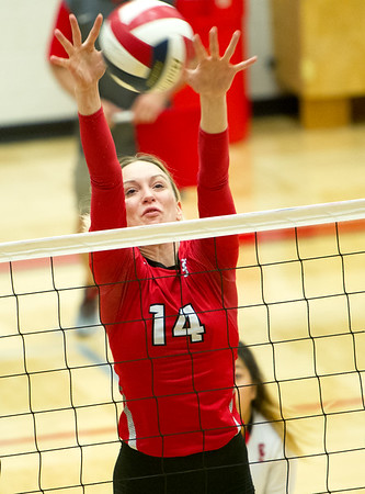 Carl Junction's Lexi Miller stretches to block a Grainville spike during a semifinal match of the Dr. Jeffrey Knutzen CJ Classic Volleyball Tournament on Saturday at CJHS.<br /> Globe | Laurie Sisk