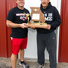 Lockwood head coach Luke Rader, left and his father, Mike Rader hold the 1974 Class A State Championship trophy that Mike Rader's team won. The elder Rader now serves as his son's assistant at Lockwood.<br /> Globe | Laurie Sisk