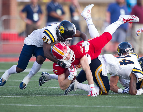 Pittsburg State receiver Brenner Clemons fights for extra yards as Central Oklahoma defensive backOmari Cole (21) works to bring him down during their game on Saturday night at Pittsburg.<br /> Globe | Laurie Sisk