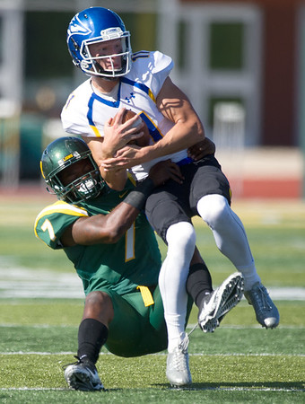 Missouri Southern's Alexander Wade (7) works to bring down Nebraska-Kearney quarterback Steve Worthing (11) during their game on Saturday at Fred G. Hughes Stadium.<br /> Globe | Laurie Sisk