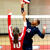 Joplin's Malia Mack (10) tries to spike the ball past Webb City's Talyn Smith (10) during their match on Tuesday night at WCHS.<br /> Globe   Laurie Sisk