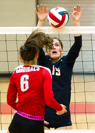 Joplin's Reilly Sitton (15) blocks a spike by Webb City's Allary Liberatore (6) during their match on Tuesday night at WCHS.<br /> Globe | Laurie Sisk