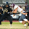 Neosho's Tre Letts (42) and Jarvis Funk (4) bring down Logan-Rogersville receiver Ryker Strong during their game on Friday night at Neosho.<br /> Globe   Laurie Sisk