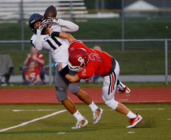 Globe/Roger Nomer<br /> Carl Junction's Teagan Armentrout forces Willard's Kenny Chambers to drop a pass during Friday's game at Carl Junction.