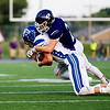 Globe/Derek Livingston<br /> Pittsburg's Drew Roelfs (23) wraps up Harrisonville's Colby Knowles (3) in Friday nights game in Pittsburg.