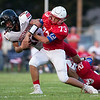 Globe|Israel Perez<br /> Seneca's Harris Grffith (73) delivers a hard tackle from the top to Cole DeLossantos (12) of McDonald Co. as Max Roark (20) of Seneca holds on to Delossantos from below during their game on Friday night at the Tom Hodge Field in Seneca High School High School