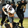 Neosho's Tre Letts (42) and Sam Cook (34) bring down Logan-Rogersville runningback Brooks Wilson (20 as Sean Moran (59) closes in during their game on Friday night at Neosho.<br /> Globe   Laurie Sisk