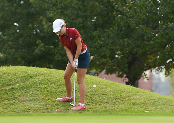 Globe/Roger Nomer<br /> Joplin's Anna Iorio hits onto the green during Monday's conference tournament at Schifferdecker Golf Course.