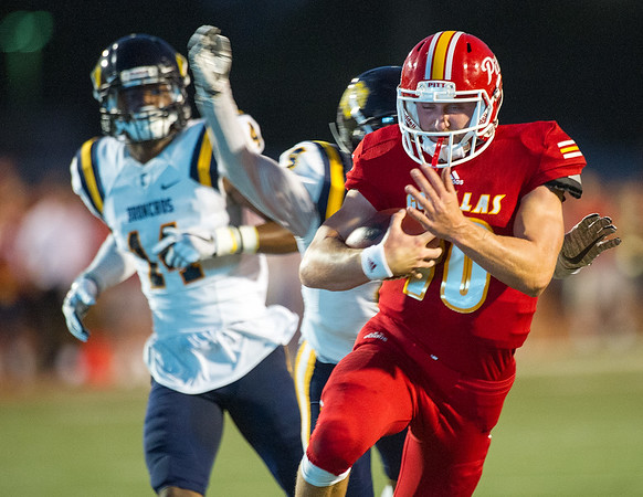 Pittsburg State quarterback Thomas LePage gets past the  Central Oklahoma defense for a long gain during their game on Saturday night at Pittsburg.<br /> Globe | Laurie Sisk