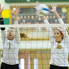 Missouri Southern's Morgan Nash (1) and Alyssa Diaz (16) try to block a spike during their match against Pittsburg State on Saturday at MSSU.<br /> Globe | Laurie Sisk