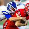 Carthage linebacker Colton Winder (31) tries to bring down Carl Junction quarterback Joe Kennedy (14) during their game on Friday night at Carl Junction.<br /> Globe | Laurie Sisk