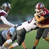 Joplin's Jake Flowers (17) works to get past Rolla's Clotn Franks (33) as Isaiah Thompson (52) looks on during their game on Friday night at Junge Stadium.<br /> Globe | Laurie Sisk