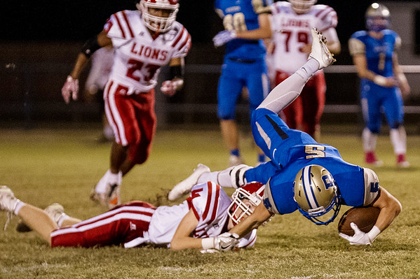 Riverton's Mikel McCann gets the first down but then it's ended by an arm tackle made by Koby Stark of Baxter Springs in the Friday night game in Riverton.