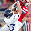 Webb City receiver Alex Gaskill (6) catches a pass for the Cardinals' first touchdown as Pittsburg's Drew Roelfs (23) defends during their game on Friday night at Webb City.<br /> Globe | Laurie Sisk