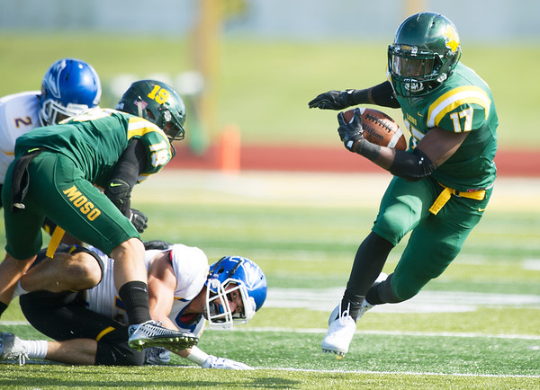 Missouri Southern runningback Shemar Coleman (17) turns upfield for a long gain during the Lions' game against Nebraska-Kearney on Saturday at Fred G. Hughes Stadium.<br /> Globe | Laurie Sisk