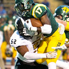 Missouri Southern's Shemar Coleman (17) battles for extra yards as Emporia State's Donovan Walker (52) defends during their game on Saturday night at Fred G. Hughes Stadium.<br /> Globe | Laurie Sisk