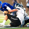 Colgan quarterback Cade Simmons (3) tries to get past Frontenac's Broc Ginavan (1) during their game on Thursday night at Pittsburg.<br /> Globe | Laurie Sisk