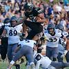 Globe/Roger Nomer<br /> Neosho's James Renfro runs the ball agains the Willard defense on Friday at Neosho.