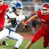 Carthage runningback Clay Newman (9) looks for blockers as Carl Junction's Lucas Hendren (33) closes in during their game on Friday night at Carl Junction.<br /> Globe | Laurie Sisk