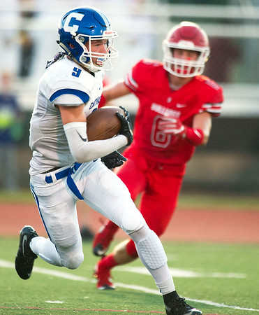 Carthage runningback Clay Newman (9) looks for blockers as Carl Junction's Caden Cristy (6) closes in during their game on Friday night at Carl Junction.<br /> Globe | Laurie Sisk