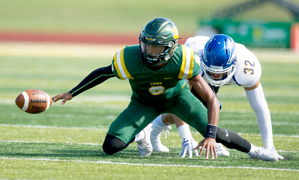 Missouri Southern quarterback Dante Vandeven (8) races to recover his own fumble as Nebraska-Kearney's Sal Silvio (32) closes in during their game on Saturday at Fred G. Hughes Stadium.<br /> Globe | Laurie Sisk