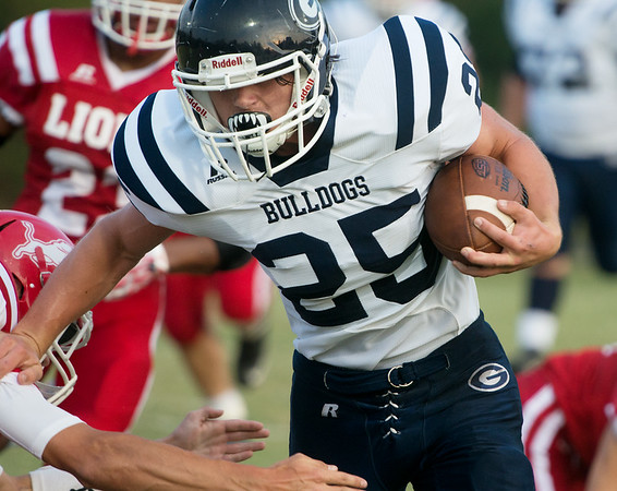 Globe/Roger Nomer<br /> Galena's Joseph Helton runs for a long gain against Baxter Springs during Friday's game in Baxter Springs.