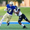 Northeastern Oklahoma A&M tight end Jace Sternberger (10) works to get past New Mexico Military Institute defensive back Lequan Lewis-Hicks (3) during their game on Saturday night at NEO.<br /> Globe | Laurie Sisk