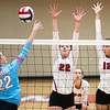 Webb City's Aubre Conway-Owen (22) tries to spike the ball past Carl Junction's Sylvia Lawson (22) and Olivia Lewis (12) during their match on Tuesday night at Webb City.<br /> Globe | Laurie Sisk