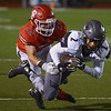 Globe/Roger Nomer<br /> Carl Junction's Colton Kennedy tackles Willard's Kobe Holloman during Friday's game in Carl Junction.