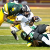 Missouri Southern's Akel Beard (21) and Keith Beverly (14) combine to stop Emporia State's Ricky VanWeezel during their game on Saturday night at Fred G. Hughes Stadium.<br /> Globe | Laurie Sisk
