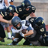 Globe/Roger Nomer<br /> Neosho's Sean Moran (59), Drew Osborn (13), Tre Letts (42) and Sam Cook (34) combine to tackle Willard's Ethan Thompson during Friday's game in Neosho.