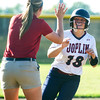 Joplin coach Jaclyn Prater congratulates senior outfielder Jozee Bartlett on her game-tieing solo home run in the fifth inning of the Eagles game against Carl Junction on Wednesday at CJHS.<br /> Globe | Laurie Sisk