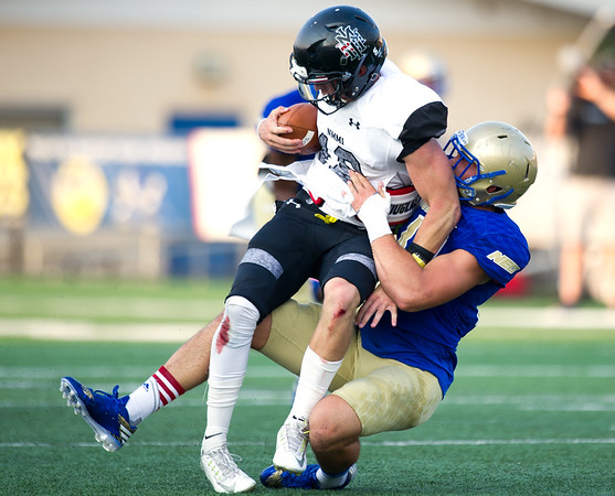Northeastern Oklahoma A&M linebackerCade Bauman brings down New Mexico Military Institute quarterback Jaime Rouse during their game on Saturday night at NEO.<br /> Globe | Laurie Sisk