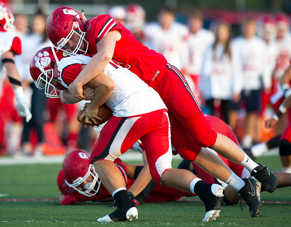 Carl Junction lineman Tyler Huffman sacks Ozark quarterback Danny Carr (18)  during their game on Friday night at CJHS. <br /> Globe | Laurie Sisk