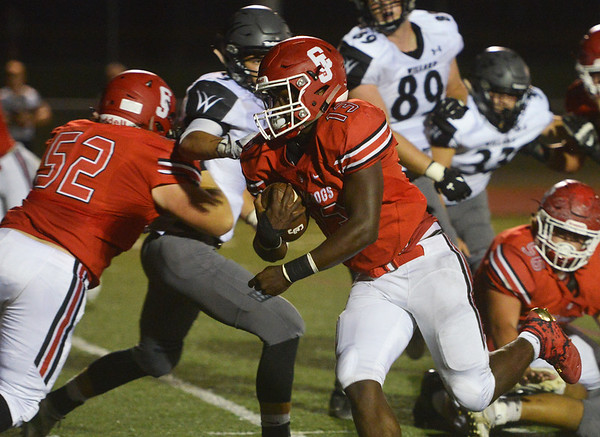 Globe/Roger Nomer<br /> Carl Junction's Rayquion Weston runs in for the first touchdown of the game against Willard on Friday.