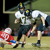 Globe|Israel Perez<br /> Cassville's Shannon Haney (17) runs the ball as teammate DJ White (right) tries to stop the tackle of Seneca's Max Roark (20) who tries to stop him from below during their homecoming game on Friday night at Seneca High School.