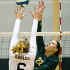Missouri Southern's Bailey Rexford (22) gets a spike past Chadron State's Andi Dowell (6) during their match on Friday at Leggett & Platt.<br /> Globe | Laurie Sisk