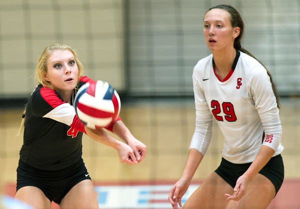 Carl Junction libero Kamryn Colburn (4) returns a serve as teammate Grace Southern (29) looks on during their match against Webb City on Tuesday night at Webb City.<br /> Globe | Laurie Sisk
