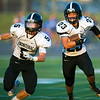 Frontenac runningback Ryan Raio follows the block of receiver Kade Chastain (5) for a long gain during their game against Colgan on Thursday night at Pittsburg.<br /> Globe | Laurie Sisk