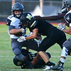 Globe/Roger Nomer<br /> Neosho's Jarvis Funk tackles Willard's Ethan Thompson during Friday's game in Neosho.