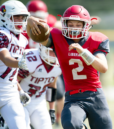 Liberal's Noah Harris (2) gets past Tipton's Blake Fischer (11) for an early touchdown during their game on Saturday afternoon at Liberal.<br /> Globe | Laurie Sisk
