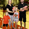From the left: Pittsburg State Volleyball Coach Jen Gomez poses with her husband, Chanc Gomez and their children, Ryder, 4, Micah, 8 and one-month-old twins Kash and Colt before the Gorillas match against Central Oklahoma on Tuesday night at John Lance Arena.<br /> Globe | Laurie Sisk