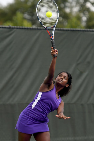 Thomas Jefferson's Johanna Jeyaraj serves during her and partner Audrey Neighmond's no. 1 doubles match against Aurora's Hannah Estes and Alexis Hoftiezer on Friday at Thomas Jefferson.<br /> Globe | Laurie Sisk