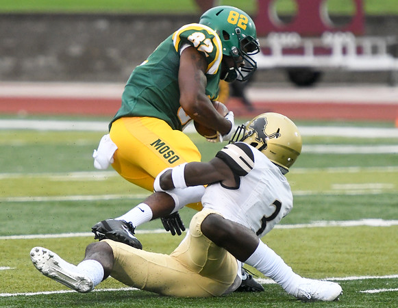 Missouri Southern's Arrion Howard (82) tries to get past Lindenwood's Tyler Green (3) during the Lions home opener on Saturday at Fred G. Hughes Stadium.<br /> Globe   Laurie Sisk