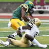 Missouri Southern's Arrion Howard (82) tries to get past Lindenwood's Tyler Green (3) during the Lions home opener on Saturday at Fred G. Hughes Stadium.<br /> Globe | Laurie Sisk