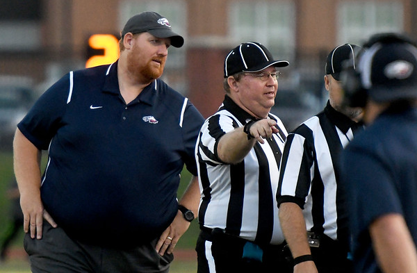 Joplin coach Curtis Jasper chats with officials during the Eagles game against Neosho on Friday night at Neosho.<br /> Globe | Laurie Sisk